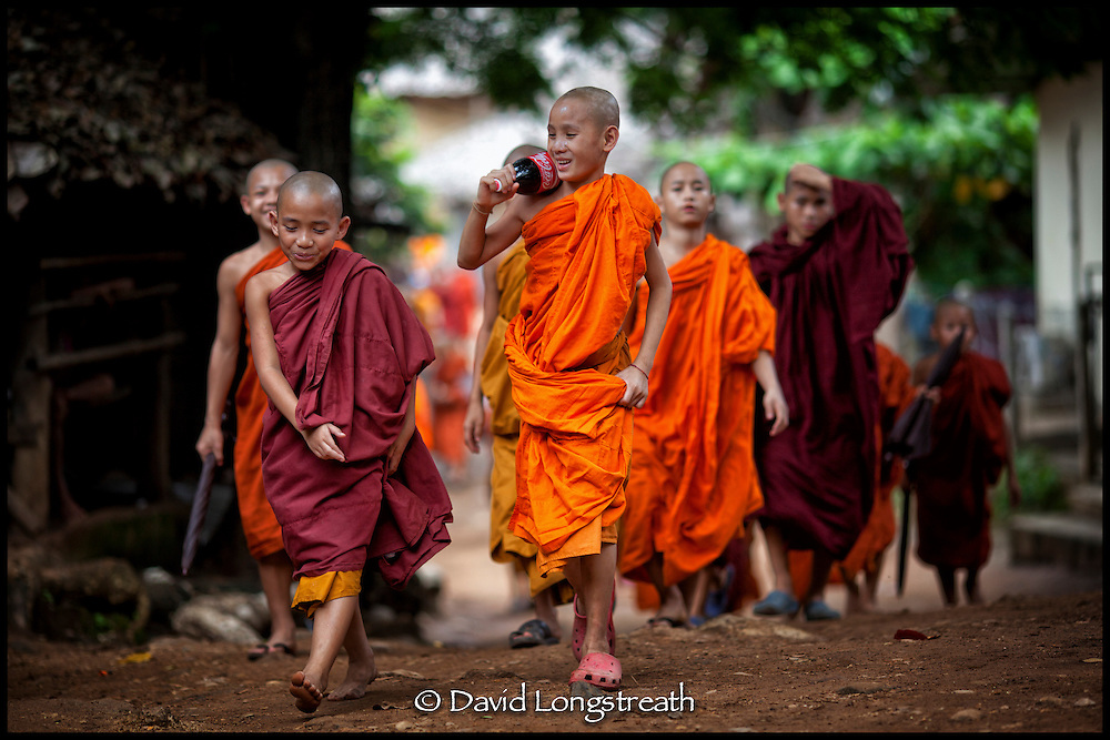 Novice Buddhist Monks return home to temple following a funeral in Mae Hla refugee camp along the Thai-Burma border