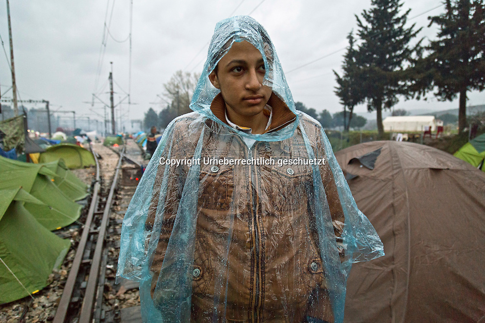 Greece, Idomeni, Refugees on their way to Europe - Eye of a Needle, Idomeni<br /> <br /> Nadeloehr nach Nordeuropa Idomeni, der Grenzuebergang ist seit Tagen gesperrt,. <br /> Es ensteht im provisorischen Fluechtlingslager in Idomeni eine ngespannte Lage. <br /> Daueregen und Kaelte machen vor allem den Familien mit kleinen Kindern zu schaffen. <br /> <br /> Idomeni, is the eye of a needle for getting to nothern Europe. <br /> The FYRO macedonian authorities, closed the border from Greece completely. The situation close to the border gets more and more difficult. The People have to sleep outside or in small tents. <br /> Heavy rainfalls and cold nights are treating the refugees badly. Some already stayed up to ten nights at Idomeni. There is not enough food and supplies to help about 14.000 refugees.<br /> <br /> <br /> <br /> keine Veroeffentlichung unter 50 Euro*** Bitte auf moegliche weitere Vermerke achten***Maximale Online-Nutzungsdauer: 12 Monate !! <br /> <br /> for international use:<br /> Murat Tueremis<br /> C O M M E R Z  B A N K   A G , C o l o g n e ,  G e r m a n y<br /> IBAN: DE 04 370 800 40 033 99 679 00<br /> SWIFT-BIC: COBADEFFXXX