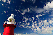North Mole Lighthouse (1903), Fremantle, Western Australia. Marks Western-most point of Fremantle Harbour. It is the last remaining of their type. It is a well known landmark to seaman visiting the port. The 15 m tower is made of cast iron, painted red and features classical decorations.
