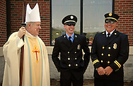 31 JULY 2011 -- IMPERIAL, Mo. -- The Most Rev. Robert J. Carlson (left), Archbishop of St. Louis, visits with firefighters from the Saline Valley Fire Protection District following the Dedication Service for the new building hosting St. John Catholic Church in rural Imperial, Mo. Sunday, July 31, 2011. The parish, located along Route 21 in Jefferson County, was established in 1869. Photo © copyright 2011 Sid Hastings.