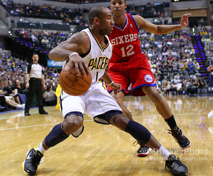 March 14, 2012; Indianapolis, IN, USA; Indiana Pacers shooting guard Dahntay Jones (1) dribbles against Philadelphia 76ers shooting guard Evan Turner (12) at Bankers Life Fieldhouse. Indiana defeated Philadelphia 111-94. Mandatory credit: Michael Hickey-US PRESSWIRE