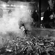 TOKYO, JAPAN - JANUARY 3 : Worshippers gather around a huge incense burner as they offer their prayers at Sensoji Buddhist temple in the Asakusa district in Tokyo, on Tuesday, January 3, 2017. (Photo by Richard Atrero de Guzman/NURPhoto)
