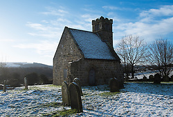 © Licensed to London News Pictures. <br /> 14/01/2015. <br /> <br /> Upleatham, United Kingdom<br /> <br /> Overnight snow lies all around St Andrew's church near Upleatham in Cleveland. The church is believed to be one of the smallest churches in the world.<br /> <br /> Photo credit : Ian Forsyth/LNP