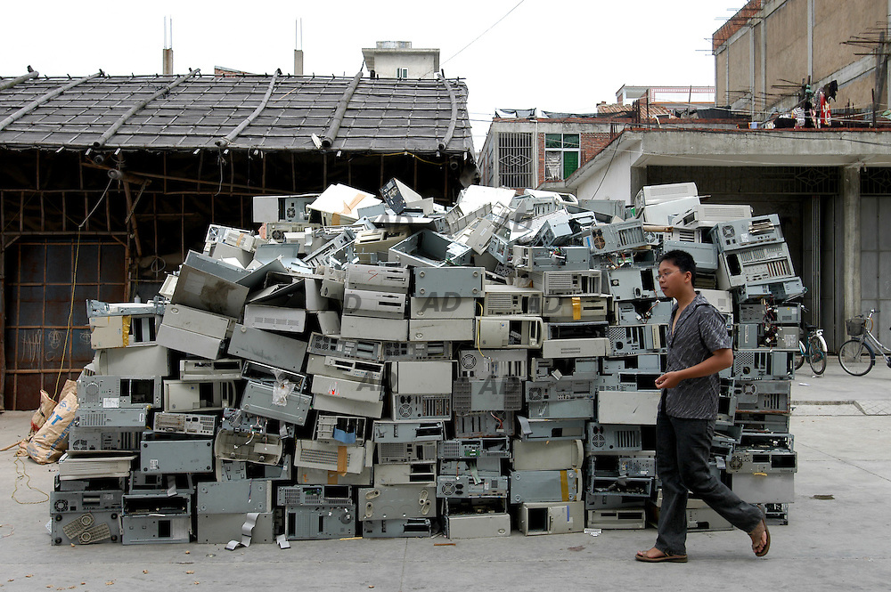 "In Chaoyang county in southern Guangdong province - China's richest - whole farming families have turned into scavengers over the last decade for extra cash..For years, so called ""e-waste"" from richer countries has found its way to China, where armies of rural poor rummage through computer monitors, central processing units, printers, toner cartridges and other high-tech trash to sell what they can to recyclers. .Plastics, metals and other recyclable materials lay in heaps everywhere, waiting to be trucked to smelters..Electronic waste can contain 1,000 different substances including lead, cadmium, chromium and mercury - heavy metals which are highly toxic..Unwanted electronic junk is seen in open rice fields everywhere, on riverbanks and in ponds, and some families in the area have stopped drinking well water because it has taken on a yellow hue..In April 2000, China specifically outlawed e-waste importation. But occasional crackdowns have done little to curtail recycling, which thrives on corruption and strong market demand.. *** Local Caption *** A pile of computerbox waiting to be dismounted."