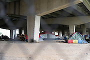 "A new ""tent city"" forms under I-30 east of downtown Dallas, Texas on May 15, 2016. (Cooper Neill for The Texas Tribune)"