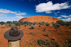 View of Uluru with bush hat in foreground in Outback Australia