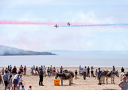 © Licensed to London News Pictures.  24/06/2018; Weston-super-Mare, North Somerset, UK. The RED ARROWS at Weston Air Festival. Air displays take place over the Seafront and Beach Lawns at Weston-super-Mare, including the Battle of Britain Memorial Flight and the Red Arrows display team. Photo credit: Simon Chapman/LNP