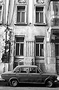 .An Old Russian car and a crumbling apartment downtown. Though being rapidly modernized there are still signs of the past. from Neighborhoods series.**Neighborhoods