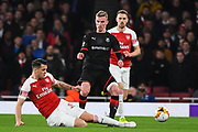 Arsenal Midfielder Granit Xhaka (34) tackles Rennes Benjamin Bourigeaud (14) during the Europa League round of 16, leg 2 of 2 match between Arsenal and Rennes at the Emirates Stadium, London, England on 14 March 2019.