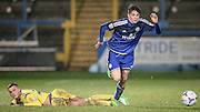 Josh MacDonald (Halifax) skips over the challenge of Oliver Norburn (Guiseley) during the Conference Premier League match between FC Halifax Town and Guiseley at the Shay, Halifax, United Kingdom on 5 December 2015. Photo by Mark P Doherty.