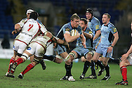 Andy Powell of the Cardiff Blues (c) is tackled by David Pollock (7) and Chris Henry (8) of Ulster. Magners league, Cardiff Blues v Ulster at the Cardiff city stadium in Cardiff on Friday 26th March 2010. pic by Andrew Orchard, Andrew Orchard sports photography,