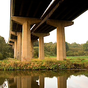Underside the A1M motorway bridge at Warmsworth crossing over the River Don.