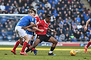 Portsmouth Defender, Matt Clarke (5) gets hold of Barnsley Forward, Victor Adeboyejo (29) during the EFL Sky Bet League 1 match between Portsmouth and Barnsley at Fratton Park, Portsmouth, England on 23 February 2019.