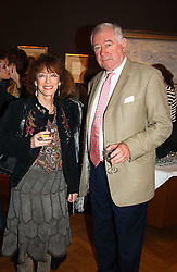 Writer BEL MOONEY and actor GEORGE BAKER at a party to celebrate the publication of an autobiography by the late Jack Rosenthal at The Fine Art Society, 148 New Bond Street, London W1 on 21st April 2005.<br />