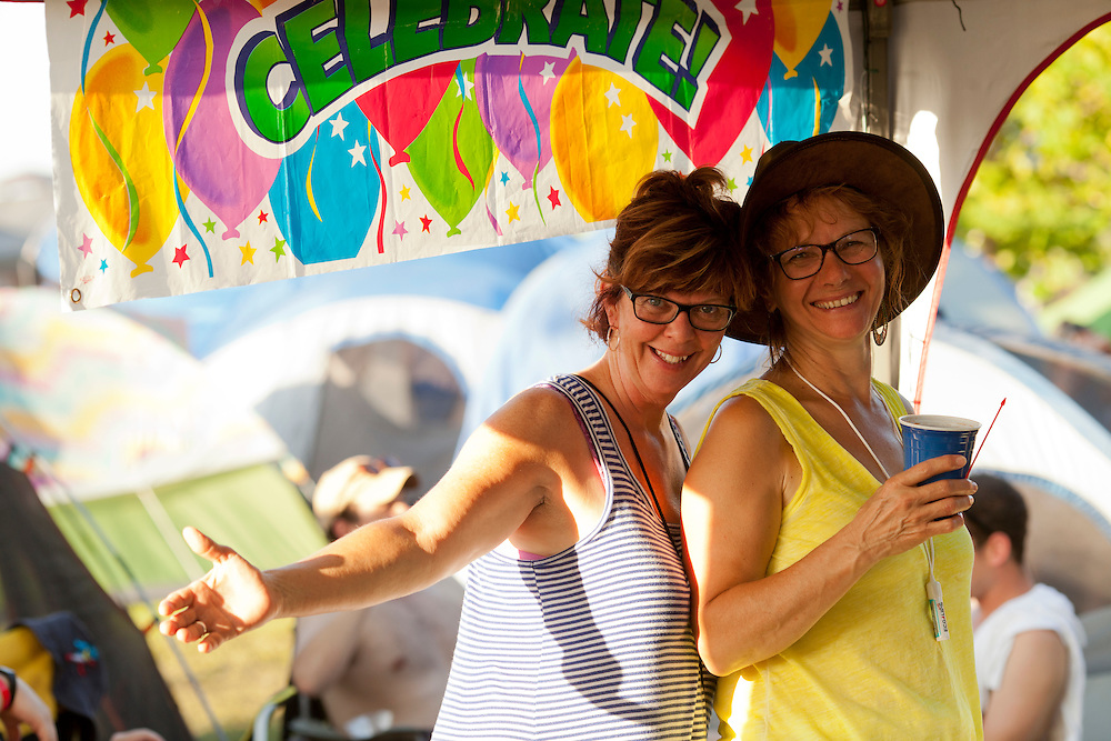 Maria Zobrist and Deb Loughrin of Iowa City beat the heat and celebrate Zobrist's birthday in their campsite at Camp Euforia on Friday, July 2015, 2015.