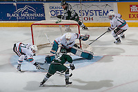 KELOWNA, CANADA - DECEMBER 30: Devante Stephens #21 of Kelowna Rockets stick checks Dawson Leedahl #12 of Everett Silvertips as he scores the winning goal in overtime on Jackson Whistle #1 of Kelowna Rockets on December 30, 2015 at Prospera Place in Kelowna, British Columbia, Canada.  (Photo by Marissa Baecker/Shoot the Breeze)  *** Local Caption *** Dawson Leedahl; Jackson Whistle; Devante Stephens;