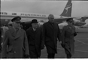 Australian Prime Minister Visits Ireland.   (H79)..1974..23.12.1974..12.23.1974..23rd December 1974..As part of his tour of E.E.C. Capital Cities,Mr Gough Whitlam, the Australian Prime Minister visited Dublin today. In Dublin he will have talks with An Taoiseach, Mr Liam Cosgrave...Image of An Taoiseach,Liam Crosgrave and the Australian prime minister, Mr Gough Whitlam, being escorted across the tarmac to view a guard of honour.