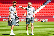 Leeds United defender Stuart Dallas (15) and Leeds United forward Helder Costa (17) arrive at the ground during the EFL Sky Bet Championship match between Stoke City and Leeds United at the Bet365 Stadium, Stoke-on-Trent, England on 24 August 2019.