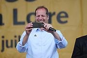 Tour de France director Christian Prudhomme takes a photo during the Tour de France 2018, Teams presentation on July 5, 2018 in La Roche-sur-Yon, France - Photo George Deswijzen / Pro Shots / ProSportsImages / DPPI