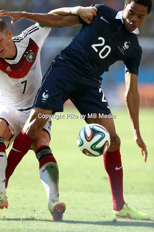 Fifa Soccer World Cup - Brazil 2014 - <br /> FRANCE (FRA) Vs. GERMANY (GER) - Quarter-finals - Estadio do MaracanaRio De Janeiro -- Brazil (BRA) - 04 July 2014 <br /> Here German player Bastian SCHWEINSTEIGER (L) and French player  Loic REMY (R)<br /> &copy; PikoPress