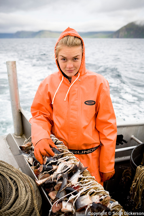 Emma Teal Laukitis, a commercial fisherwoman, prepared to set out longline gear while fishing for halibut in the Aleutian Islands, Alaska.