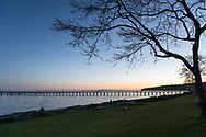Sunset view of White Rock Beach, the White Rock Pier and Boundary Bay at sunset.  Photographed from the Promenade in White Rock, British Columbia, Canada.