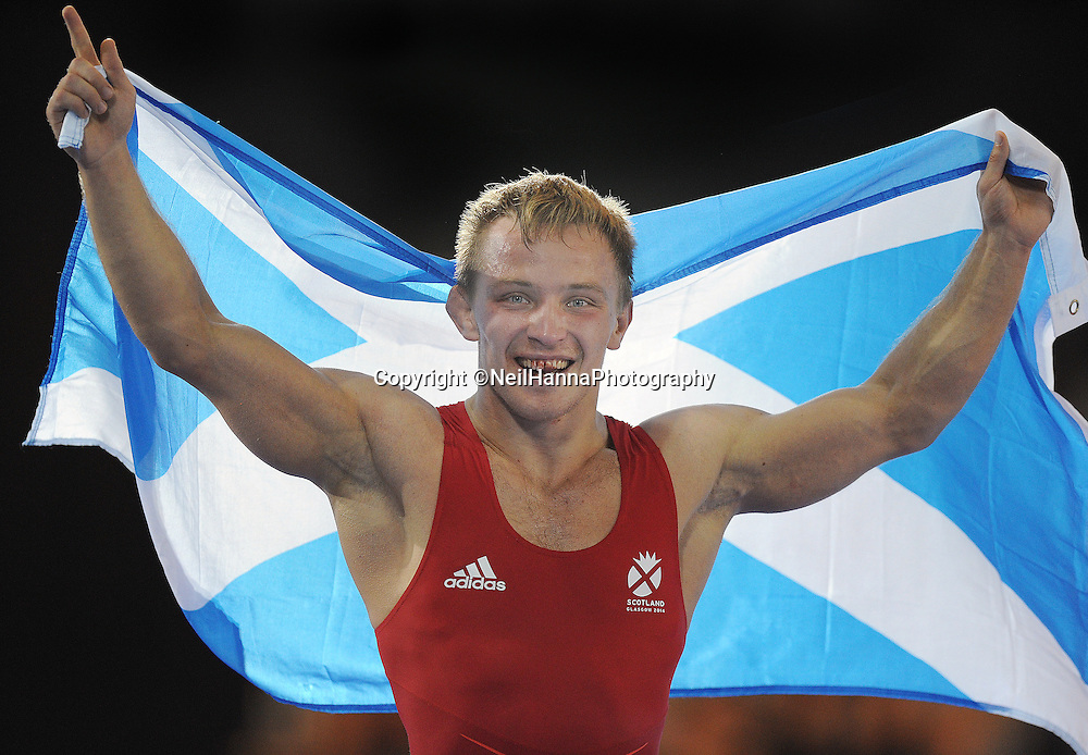 Commonwealth Games, Glasgow 2014<br /> SECC Wrestling 31.07.2014<br /> <br /> Mens 65kg Bonze Medal Match<br /> <br />  Alex Gladkov  of  Scotland celebrates a Bronze medal<br /> <br /> <br /> Neil Hanna Photography<br /> www.neilhannaphotography.co.uk<br /> 07702 246823