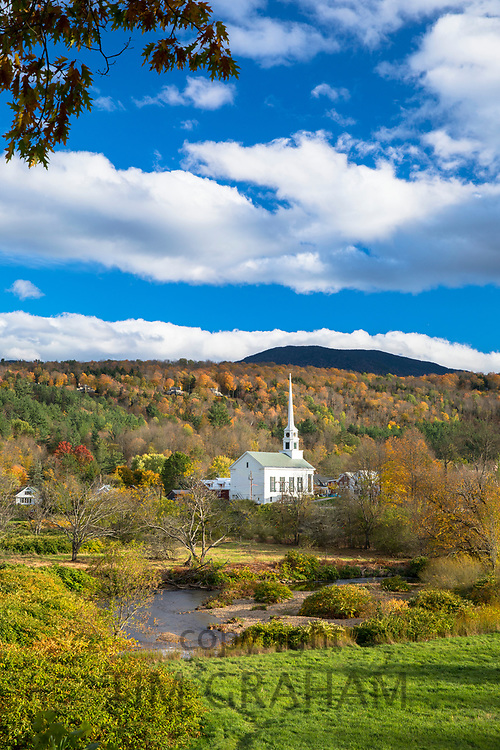 Typical New England scene - Stowe Church in a landscape of Fall foliage colours in Vermont, USA