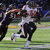 15 January 2012: Baltimore Ravens linebacker Brendon Ayanbadejo (51) pulls down Houston Texans wide receiver Jacoby Jones (12) on a punt return in the Divisional Playoff at M&T Bank Stadium in Baltimore, MD. The Ravens defeated the Texans 20-13 to advance to the AFC Championship game..