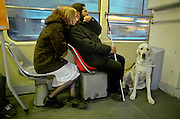Mario Bihari with Alenka and his guiding dog Harley in a Prague tramway. Mario is a well known blind Roma musician originally from Slovakia living since he finished his studies in Prague, Czech Republic. Beside being a very talented multi-instrumentalist working as a professional musician he is also experimenting with photography as a another way to express himself.