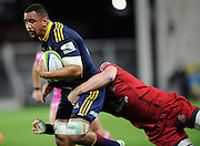 Nasi Manu in action for the Highlanders. Investec Super Rugby - Highlanders v Reds 27 February 2015, Forsyth Barr Stadium, Dunedin, New Zealand. Photo: New Zealand. Photo: Richard Hood/www.photosport.co.nz