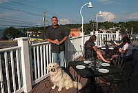 Richard Ray Proprietor and his dog Madison on the deck of the Lobster Pound Seafood and Italian Cuisine at Weirs Beach.   (Karen Bobotas/for the Laconia Daily Sun)