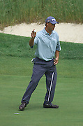 Jun 26, 2006; Gaylord MI; Chris DiMarco acknowledges the gallery after making birdie and winning a skin on the third hole during the ING Par-3 Shootout at Treetops Resort in Gaylord Michigan.