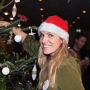 NLD/Hilversum /20131210 - Sky Radio Christmas Tree For Charity 2013, Lucille Werner versierd haar boom