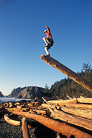Man balancing on one leg Rialto Beach Washington USA&#xA;<br />
