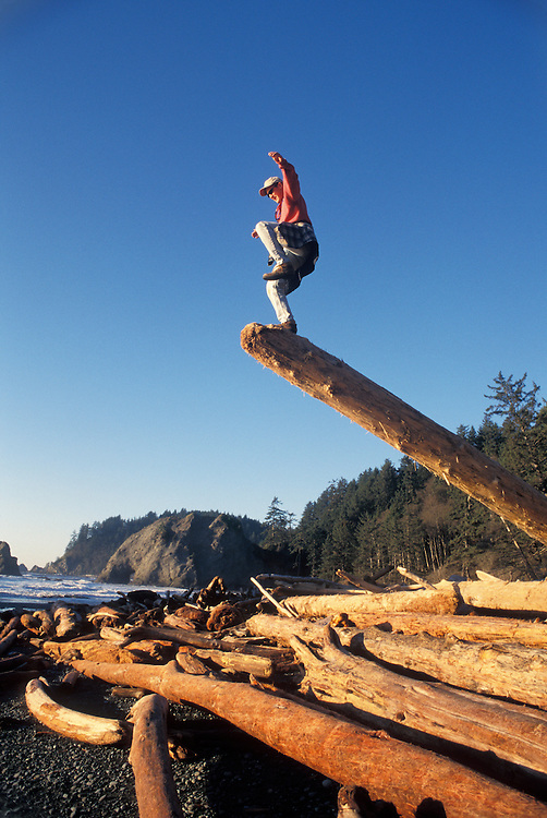 Man balancing on one leg Rialto Beach Washington USA&amp;#xA;<br />