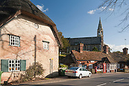 The Thames village of Clifton Hampden with a view of the Post Office and Church of St Michael and All Angels, Oxfordshire, Uk