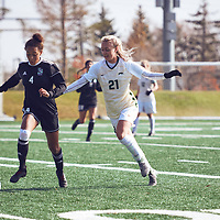 2nd year forward, Sally Bachmann (21) of the Regina Cougars during the Women's Soccer home game on Sun Oct 07 at U of R Field. Credit: Arthur Ward/Arthur Images
