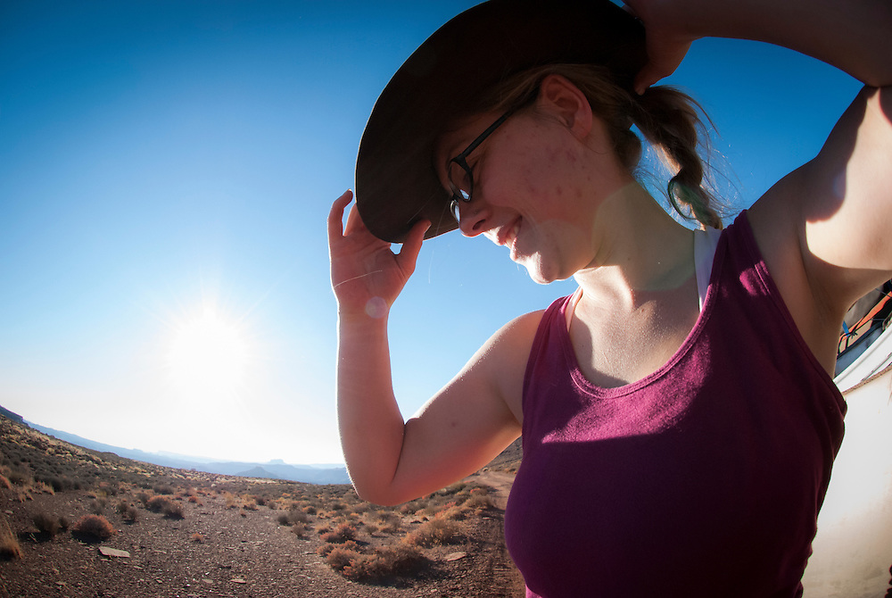 A woman adorns herself in a Stetson cowboy hat while touring the White Rim Trail near Moab, Utah.