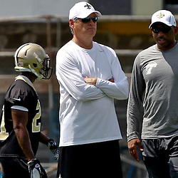 June 5, 2012; Metairie, LA, USA; New Orleans Saints general manager Mickey Loomis and Tulane Green Wave head coach Curtis Johnson talk on the sideline during a minicamp session at the team's practice facility. Mandatory Credit: Derick E. Hingle-US PRESSWIRE