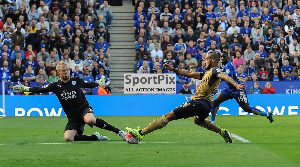 Kasper Schmeichel saves at the feet of Theo Walcott (c) Simon Kimber | SportPix.org.uk