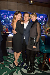 Left to right, LISA SNOWDON, STEPHEN WEBSTER and ASSIA WEBSTER at a party to celebrate the launch of the Lisa Snowdon jewellery collection for QVC held at Sexy Fish, Berkeley Square, London on 12th January 2016.