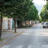 MOSTAR, BOSNIA AND HERZEGOVINA - JUNE 26:  A tree line street leading to the Hero Hotel which used to be front line in Muslim-Croatian war front on  June 26, 2013 in Mostar, Bosnia and Herzegovina.The Siege of Mostar reached its peak and more cruent time during 1993. Initially, it involved the Croatian Defence Council (HVO) and the 4th Corps of the ARBiH fighting against the Yugoslav People's Army (JNA) later Croats and Muslim Bosnian began to fight amongst each other, it ended with Bosnia and Herzegovina declaring independence from Yugoslavia.  (Photo by Marco Secchi/Getty Images)