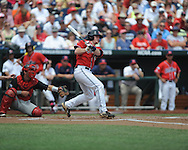 Mississippi's Austin Anderson (8) vs. Texas Tech at T.D. Ameritrade Park in the College World Series in Omaha, Neb. on Tuesday, June 17, 2014. Ole Miss won 2-1.