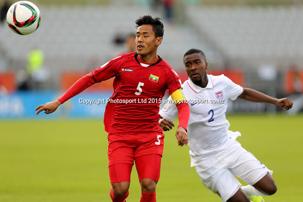 Nanda Kyaw of Myanmar, left, is chased by Shaquell Moore of USA in the Group A FIFA U20 World Cup Match between USA and Myanmar at Northlands Event Centre, Whangarei, Northland, New Zealand, Saturday, May 30, 2015. Copyright photo: David Rowland / www.photosport.co.nz