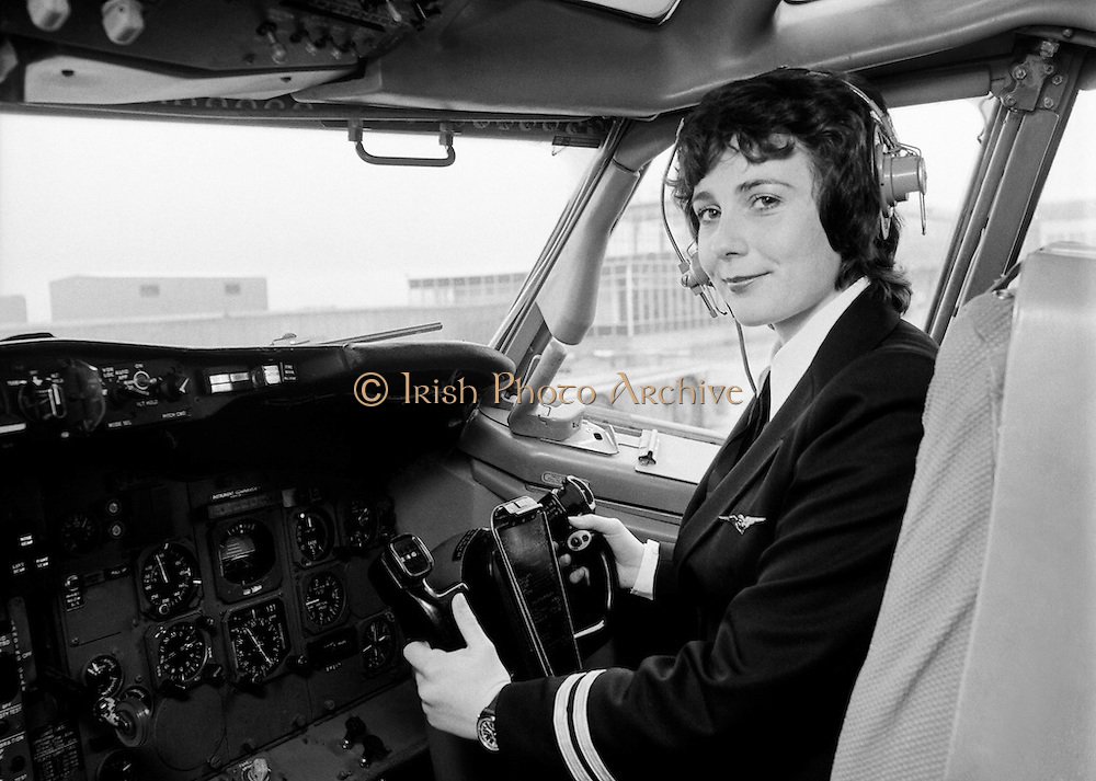Grainne Cronin (23) in the cockpit of a Boeing 737. Formerly a stewardess with Aer Lingus, she became the first female pilot with the airline. Ms Cronin, from Ennis, Co. Clare, was the daughter of  Aer Lingus Captain Felim Cronin. She reached the rank of Captain in 1988. Her last flight saw her captain an all-female crew aboard an Airbus A330 to Boston. She retired after 33 years of service.<br />