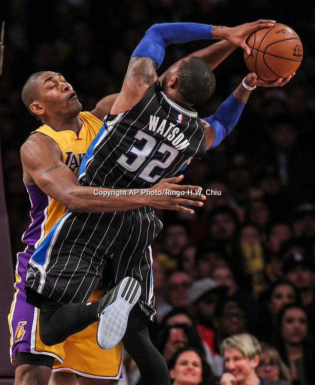 Los Angeles Lakers forward Metta World Peace, left, defends Orlando Magic guard C.J. Watson during the second half of an NBA basketball game Tuesday, March 8, 2016, in Los Angeles.  Lakers won 107-98. (AP Photo/Ringo H.W. Chiu)