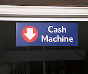 Sign with arrow pointing to Cash Machine