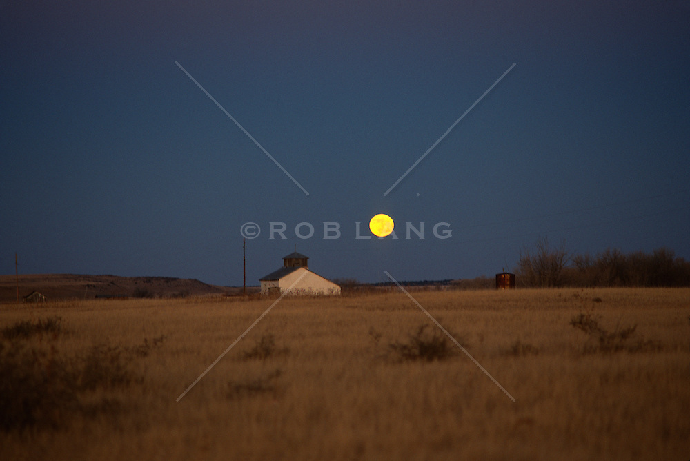 Moon rising over a Church in New Mexico