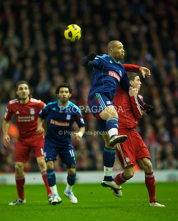 LIVERPOOL, ENGLAND - Wednesday, February 2, 2011: Liverpool's Daniel Agger and Stoke City's John Carew during the Premiership match at Anfield. (Photo by David Rawcliffe/Propaganda)